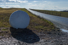 Backlit Bale (David Guidas) Tags: hay rural road gravel sunlight backlight winter plastic wrapped white round clouds field leica m9 summicron roadside bale