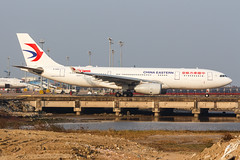 """CHINA EASTERN A330-243 B-5942 """"60th Anniversary"""" 004 (A.S. Kevin N.V.M.M. Chung) Tags: aviation aircraft aeroplane airport airlines airbus plane spotting macauinternationalairport mfm taxiway a330200 a330 chinaeastern speciallivery"""