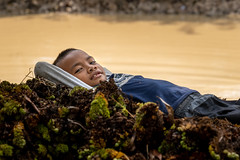 A well earned rest (joshlphotography) Tags: kid boy khmer cambodia rest sleep pond water happyplanet asiafavorites