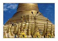 Pagoda close up (Armin Fuchs) Tags: arminfuchs yangon myanmar rangoon burma shwedagonpagoda pagoda gold blue sky clouds lamps buddha buddhism