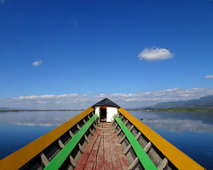 Alone on the lake (Claire Backhouse) Tags: myanmar burma burmese lake boat cruise tour exploring inlelake inle nyuangshwe bluesky clear clean beautiful water river reflection