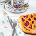 Raspberry pie with a Cup of tea and Cutlery