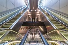 Escalators 1 (genf) Tags: roltrap roltrappen station indoor binnen escalator escalators symmetry symmetrie public openbaar vervoer amsterdam sony a99ii tamron 1530 traffic passage passengers