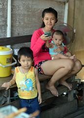 multi-tasking mother (the foreign photographer - ฝรั่งถ่) Tags: woman mother multitasking baby son children khlong lard phrao portraits bangkhen bangkok thailand nikon d3200