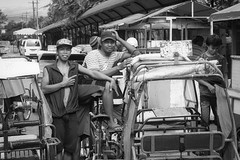 Pedicab Riders (Beegee49) Tags: striseet pedicab riders men posing blackandwhite monochrome bw people tricycle happy planet luminar sony a6000 silay city philippines asia