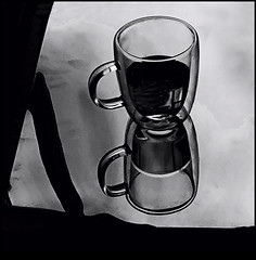 Still life glass cup (Bob R.L. Evans) Tags: coffee coffeecup glasscup blackandwhite graytones composition unusual drink breakfast kitchen minimalism reflection availablelight curves