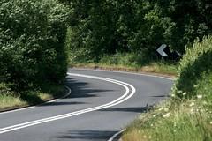 Bends (Heaven`s Gate (John)) Tags: bend road tarmac white lines hedge trees green sunlight quiet warwickshire england johndalkin heavensgatejohn abendintheroad notraffic nocars 10faves