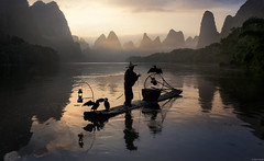 Cormorants and raft (Dan_Fr) Tags: guilin guangxi xingping li river china asia yangshuo cormorant fisherman bird dawn sunrise tradition custom travel lanscape mountain hill karst scenery water reflection light lamp sky amazing beautiful raft boat bamboo sony a7r