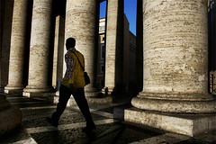 tra le colonne di san pietro (duegnazio) Tags: italia lazio roma canon350d sanpietro basilica church esterno colonne colonnato walking persona man italy rome