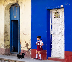 Morning Tug of War, Trinidad, Cuba (creditflats) Tags: child school girl dog walk unexco world heritage site trinidad cuba city street building house sidewalk tug olympus pen ep5 prime morning colour colort color