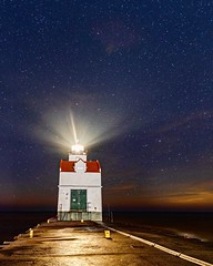 Kewaunee at Night (Daniel000000) Tags: lighthouse light water great lakes michigan wisconsin midwest explore yellow night stars nikon slow shutter shining nature landscape art old galaxy space dark red white reflections sky orange