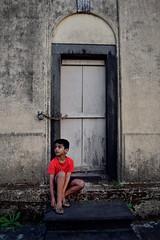 I will open History (rajeshvengara) Tags: rajastomb coorg child boy karnataka rajeshvengara vengararajesh vengara madikkeri door lock wall red