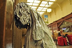 Weeping Girl (AntyDiluvian) Tags: gothenburg sweden swedish trainstation centralstation signs banners corridor sculpture statue weepinggirl girlcrying lauraford
