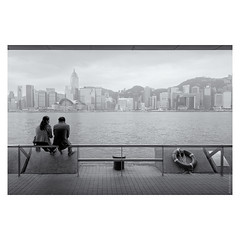 An Urban Discussion (Ian Smith (Studio72)) Tags: rx100 sonyrx100 sony hongkong hk city cityscape victoriaharbour couple people talking sitting urban blackandwhite bw bnw nb mono monochrome studio72