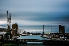 Sharpness Docks... (Jess Feldon) Tags: sharpness sharpnessdocks gloucestershire water longexposure sky clouds buildings jessfeldon cranes bridge bigstopper