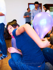 Noe and the Balloon 08 (ArdieBeaPhotography) Tags: girl preteen blue top black hair orange balloon jump leap catch hit purple jeans inside pop highcontrast slim pretty cute fringe arms lift raise bounce string rubber latex toy play fun sit stand tamronspaf2875mmf28xrdildasphericalif