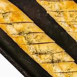 Fresh baked Bread Bruschetta on the baking tray thumbnail