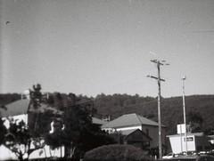 Blurry power lines pole (Matthew Paul Argall) Tags: hanimex108f fixedfocus 110 110film subminiaturefilm lomographyfilm blackandwhite blackandwhitefilm 100isofilm plasticlens cheaplens toycamera