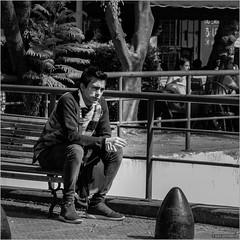 The dilemma (John Riper) Tags: johnriper street photography straatfotografie square vierkant bw black white zwartwit mono monochrome john riper fuji fujifilm xt2 xf 18135 buenos aires argentina cigarette pose bench contemplation dubbing thinking own world