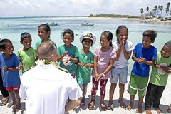 Rear Adm. Joey Tynch talks with Marshallese children.