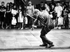 where words fail, music speaks (gro57074@bigpond.net.au) Tags: stphotographia wherewordsfailmusicspeaks fiddler fiddle f28 2470mmf28 tamron d850 nikon people crowds 2019 march guyclift movement motionblur streetphotography monochromatic monotone monochrome mono bw blackwhite violinist street musician violin
