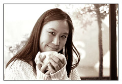 Woman with cosy cup of tea in cafe BW - Edited (Martyn.Hayes) Tags: tea coffee latte cappuccino cafe bistro diner bar pub drink hotdrink calm relaxing chilledout calming easygoing seat window daylight portrait woman portraiture tree nature day whitejumper model asian london greenwich rain wetweather indoors dry wet blackhair cosy warm comfortable whitesleeves hands cup mug hot rainonwindow damp raindrops