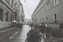 Roma (goodfella2459) Tags: nikonf4 afnikkor24mmf28dlens fomapanretropan320 35mm blackandwhite film analog roma city streets italy rome road buildings pedestrians bwfp