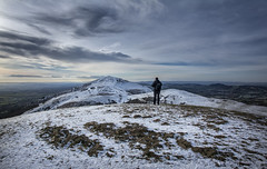 Contemplation (cliveg004) Tags: malvernhills northhill worcestershirebeacon malvern worcestershire hills snow sky clouds swirl muted winter frost cold rollinghills rocks landscape countryside herefordshire nikon d5200