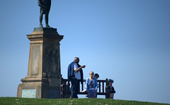 Below the Captain Cook Memorial at Whitby (Tony Worrall) Tags: yorkshire yorks scene scenery northyorkshire resort yorkshirephotos east eastern seasidetown holidays tourists coast photographsofwhitby whitbyphotos whitby north update place location uk england visit area attraction open stream tour country item greatbritain britain english british gb capture buy stock sell sale outside outdoors caught photo shoot shot picture captured ilobsterit instragram sculpture statue candid people sunlit captaincookmemorial