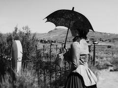 Grave Concerns (Skeptiq_1) Tags: nikond700 nikond750 nikon50mmf18 nikon80200mmf28 nikon nikkor d700 d750 50mm 80200 zoomlens photo photos photography photographer fx fullframe black white bw whiteandblack blackandwhite monochrome outdoors woman parasol grave cemetery bodie ghosttown california usa unitedstates day light