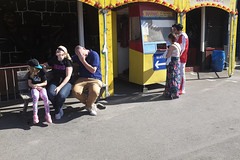 Family sat on a bench (kevin Akerman) Tags: bench family father daughters porthcawl elvis festival coney beach