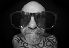 The Portraited Selfie Fisheyed approach. . . (CWhatPhotos) Tags: cwhatphotos bw mono large sunglasses sun shades glasses digital camera photographs photograph pics pictures pic picture image images foto fotos photography artistic that have which with contain olympus omd em5 mkll fisheye fish eye 8mm pro lens portrait man male smile eyes wide angle beard goatee tattoos tattooed tattoo ink inked tribal bald baldy slap head