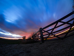 If I hide Here The Sky Won't See Me (RS400) Tags: sky clouds blue long exposure wow cool amazing landscape outside gate lights light blur night time dark olympus fence tree trees photography uk southwest bristol land red