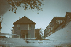 (cara zimmerman) Tags: 35mmfilm puddle reflection downtown indianapolis expiredfilm rain house