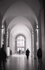 There's light at the end of the tunnel (Yutaka Seki) Tags: hall hallway arches door frame architecture people silhouette dynamic blackandwhite film analogue kentmere400 konicaautos2 homedeveloped blazinal rodinal grainy grain shadows highlights tunnel angles curves