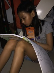 focused on coloring :) (ghostgirl_Annver) Tags: asia asian girl annver teen preteen child kid daughter sister family portrait coloring painting drawing sitting book legs