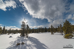 Blocking Out the Sun (kevin-palmer) Tags: bighornmountains bighornnationalforest wyoming nikond750 samyang rokinon14mmf28 snow snowy winter cold sun shadow clouds blue sky