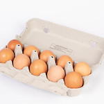 Eggs in a box on white background thumbnail