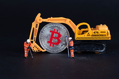 Miniature excavator with workers and Bitcoin (wuestenigel) Tags: finance coin workers money mining market digital bitcoin miners bussiness digger digging excavator cryptocurrency btc noperson keineperson vehicle fahrzeug technology technologie business geschäft machine maschine precision präzision car auto industry industrie transportationsystem transportsystem desktop action aktion equipment ausrüstung conceptual konzeptionell time zeit competition wettbewerb