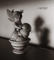 Ice cream fairy (A. K. Hombre) Tags: bnw blancoynegro blacknwhite blackandwhite macro shadow chiaroscuro icecream fairy canon powershotsx530hs indoor