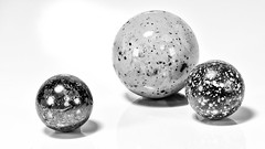 Speckled Glass Marbles (roseysnapper) Tags: heliconfocus ledlighting macromondays blackandwhite focusstack glassmarble speckledglass whitebackground lighroom macro photoshop glass marble monochrome reflection shadow speckled