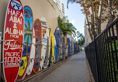 Surfboard Alley (Karen_Chappell) Tags: waikiki hawaii travel surf surfboard city urban usa oahu fence road path alley red blue yellow multicoloured colourful colours colour color