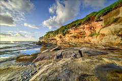 In the distance (JustAddVignette) Tags: australia clouds deewhy headland landscapes newsouthwales northernbeaches ocean reflections risingtide rocks seascape seawater sky spray swell sydney water waves