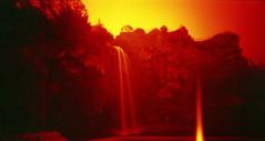 Cascade de Salles-la-Source, Aveyron, France. (matériel brouilleur) Tags: holga 120 wpc stenope pinhole lensless lomography lomo redscale expiredfilm cascade salleslasource aveyron lightleak waterfall panorama