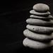 Grey Balanced Stones on the black background