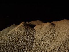a space like night (dittegroengaard) Tags: gravel piles night light articifial dunes construction newmoon aarhus denmark sky olympuse510 olympus city spacy