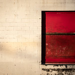Red Loading Dock Door White Bricks thumbnail