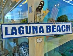 Laguna Beach (Art By Pem Photography: Tao Of The Wandering Eye) Tags: fineartphotography panasonic dmcfz28 lagunabeach california southerncalifornia socal sign shop shopwindow storefront travel usa reflection reflections