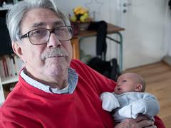 Dans les bras de Pouna (Dahrth) Tags: gf1 lumix20mm microquatretiers grandfather grandpère bébé baby portrait bokeh