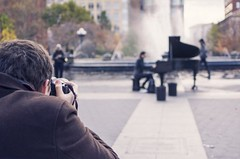 Man Capturing a Photo of a Piano Player by MusicOomph, on Flickr
